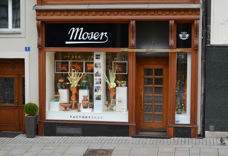 KARLOVY VARY, CZECH REPUBLIC - MAY 27, 2014: The facade of the Czech glass store Moser Sajtókép