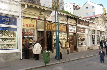 KARLOVY VARY, CZECH REPUBLIC - FEBRUARY 07, 2007: Souvenir shops on the city street Sajtókép