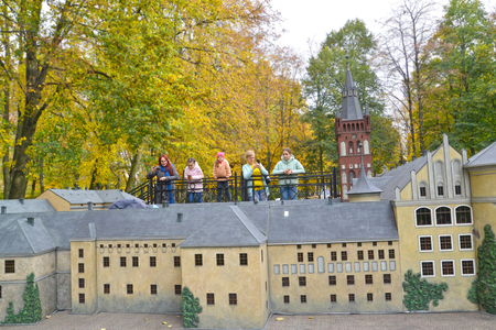 KALININGRAD, RUSSIA - OCTOBER 19, 2019: Tourists examine the layout of the Royal Kenigsberg Castle in South Park. Miniature Park History in Architecture