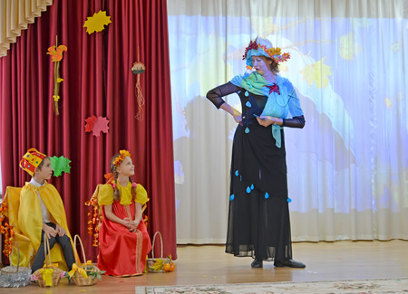 KALININGRAD, RUSSIA - OCTOBER 31, 2019: Children and teacher perform at autumn morning in kindergarten