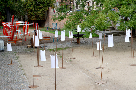 TORUN, POLAND - AUGUST 25, 2018: Installation with white men s shirts on the grounds of the old town