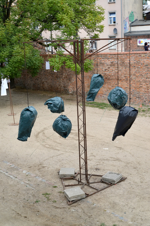 TORUN, POLAND - AUGUST 25, 2018: Composition with black garbage bags on the territory of the old city