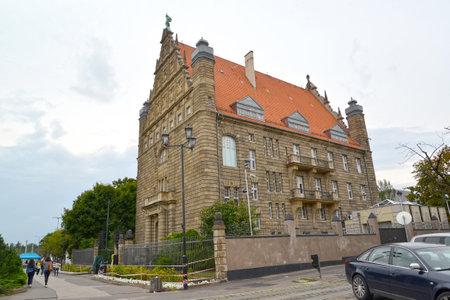 TORUN, POLAND - AUGUST 25, 2018: Museum of the University of Nikolay Copernicus on an overcast day Sajtókép