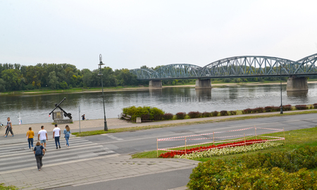 TORUN, POLAND - AUGUST 25, 2018: A view of the Josef Pilsudsky Bridge and the embankment of the Visla River