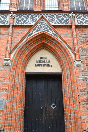 Front door to the house of Nikolai Copernicus (15th century). Torun, Poland. Polish text