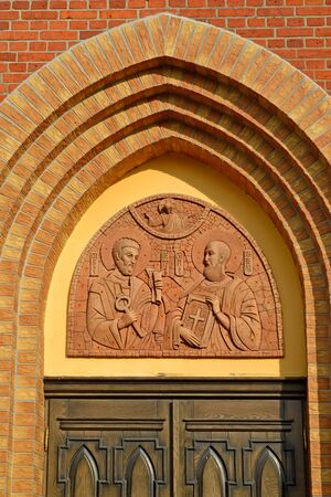 The temple icon above the entrance to the temple of the holy primordial apostles Peter and Paul. Krasnoznamensk, Kaliningrad region