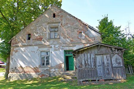 Dilapidated house of German construction. Novostroevo village, Kaliningrad region. Stock Photo