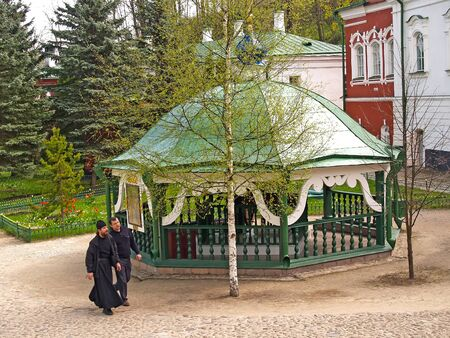 PECHORY, RUSSIA - MAY 09, 2010: People on the territory of Pskovo-Pechorsky Saint-Assumption male monastery. Pskov region Sajtókép