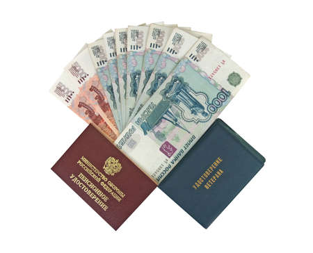 Soldier 's pension certificate, veteran 's certificate and money. Russian text - Veteran 's pension certificate, Ministry of Defense of Russia