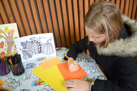 KALININGRAD, RUSSIA - OCTOBER 13, 2019: Girl draws on colored paper. Outdoor Children 's Master Class Editorial