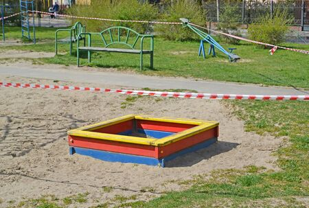 The sandbox on the playground is fenced with signal tape during the COVID-19 coronavirus epidemic in Russia. Kaliningrad