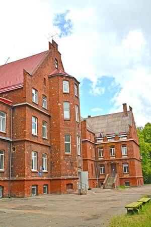 A fragment of the inner facade of the central city hospital (former House of the Poor, 1908). Sovetsk, Kaliningrad region Stock Photo