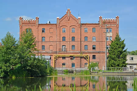 The building of the old water mill on the banks of the Angrapa River, 1898. Ozersk, Kaliningrad region 스톡 콘텐츠