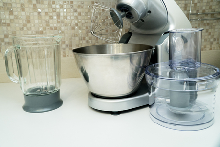 disassembled multifunctional food processor on kitchen countertops