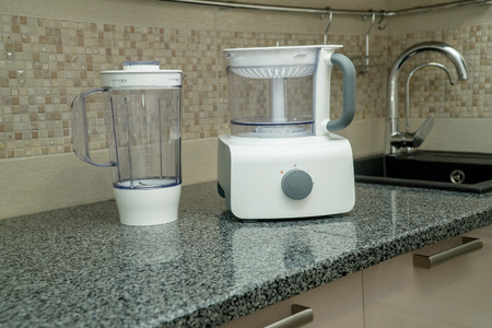 disassembled multifunctional food processor on kitchen countertops. Smoothie Maker. Electric Kitchen and Household Domestic Appliance