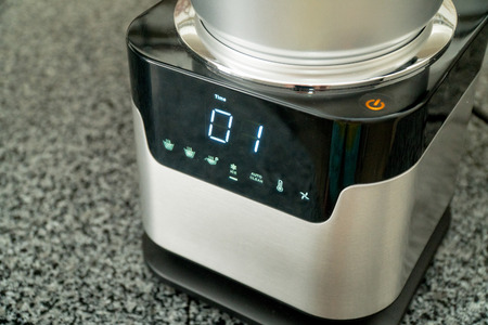 Blender with touch-screen in the kitchen. Electric Kitchen and Household Domestic Appliance Stock Photo