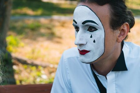 Close-up of a young man mime in a park