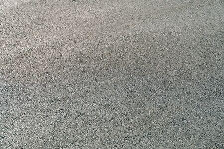 Seamless tarmac dark grey grainy road. Texture background Stock fotó