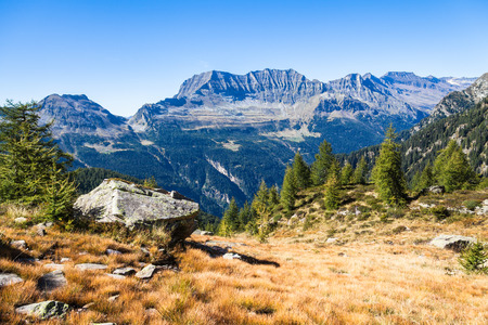 hiking: View of the mountains and valley on the hiking trail near Buffalora hut in ticino, Switzerland Stock Photo