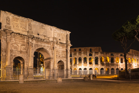 constantine: Night view of Arch of Constantine and colosseum in Rome, Italy Stock Photo