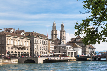 river side: View of Grossmunster Church in Zurich old town, on the river side of Limmat, Zurich, Switzerland