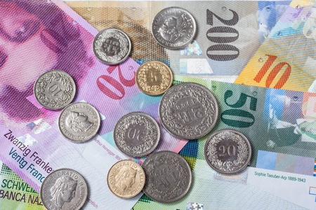 swiss franc note: Banknotes and coins of swiss currency as background Stock Photo
