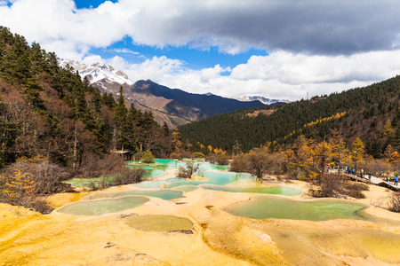 huang: View of the colorful ponds in Huanglong national park in Sichuan province, China