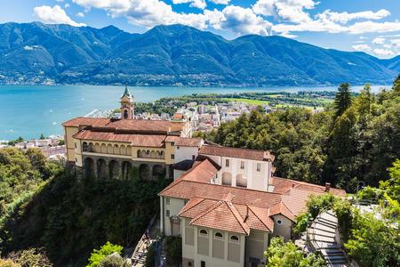 View of Madonna del Sasso Church above Locarno city and the Maggiore lake in Ticino, Switzerland photo