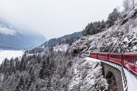 Famous sightseeing train in Switzerland, the Glacier Express in winter