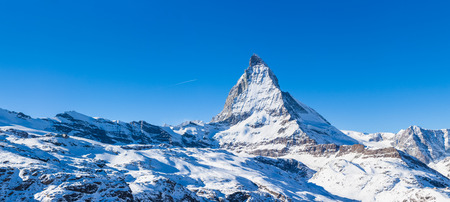 winter sky: Panorama view of Matterhorn on a clear sunny day from gornergrat train station Stock Photo