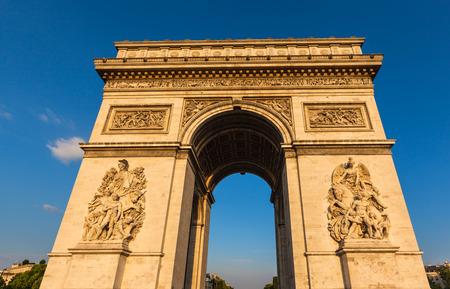 triumphe: Arc de Triomphe (Arch of Triumph) in the setting sunshine, Paris, France Stock Photo