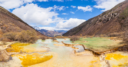 huang: Stunning view of colorful ponds and mountains in Huanglong national Park, Sichuan Province, China