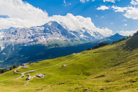 eiger: Panoramic view of famous peaks Eiger, Monch and Jungfrau, swiss alps on Bernese Oberland, Switzerland Stock Photo