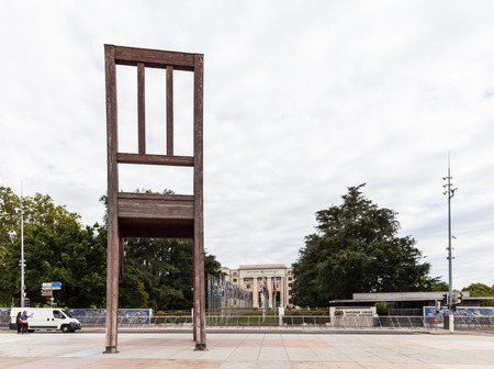 broken chair: Geneva, Switzerland - August 23, 2014 - Broken Chair sculpture on the Place des Nations, in front of the UN offices in Geneva , Switzerland. It symbolises opposition to land mines and cluster bombs.