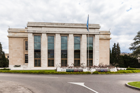Geneva, Switzerland - August 23, 2014 - Office building of the United Nations at Geneva (UNOG) wtih the flag of UN in front. Photo taken at the exit of the guided tour. Editorial