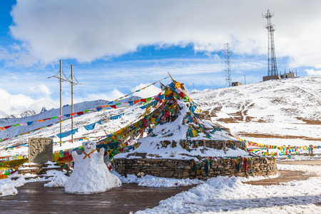 sutra: Sutra streamers oTibetan Buddhism and snowman at the view point on the road between Huanglong national park and Jiuzhaigou in Sichuan Province, China