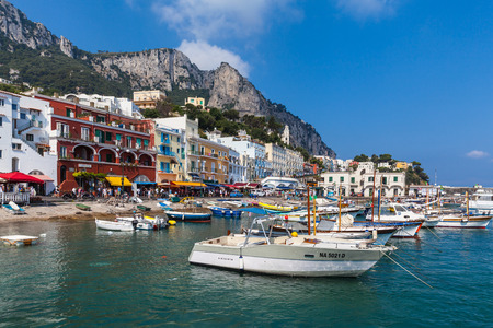 Capri, Italy - July 11, 2013 - Harbor of the famous tourism place Capri island with a lot of visitors in Italy.