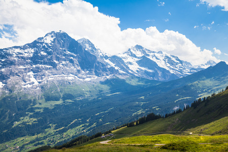 monch: Panoramic view of famous peaks Eiger, Monch and Jungfrau, swiss alps on Bernese Oberland, Switzerland Stock Photo