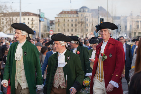 guilds: Zurich, Switzerland - April 13, 2015 - Group of men in traditional costumes on the traditional annual spring parade of Guilds (Sechselauten or Sachsiluute) as celebration of end of winter. Editorial