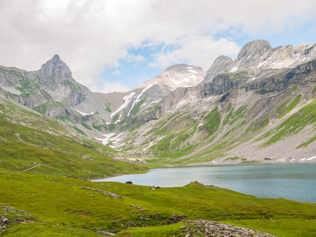 glarus: View of the Glattalpsee lake and Ortstock in the valley Braunwald Switzerland