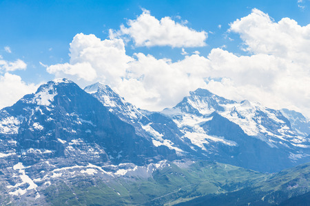the bernese oberland: Panoramic view of famous peaks Eiger Monch and Jungfrau swiss alps on Bernese Oberland Switzerland Stock Photo