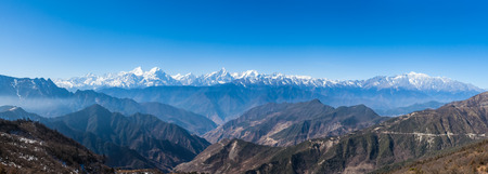 Panorama view of the mountain range including Minya Konka 7556m from top of cattle back mountain in the morning Sichuan Province China photo