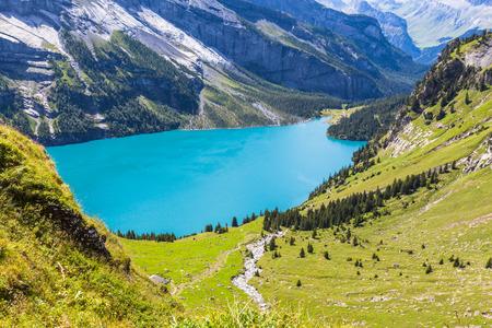 oberland: View of the Oeschinensee Oeschinen lake near Kandersteg on bernese oberland in Switzerland. Stock Photo
