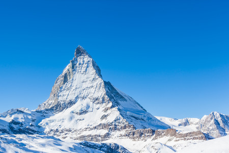 clear path: Close view of Matterhorn on a clear sunny day on the winter hiking path, Zermatt, Switzerland.