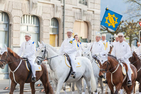 guilds: Zurich Switzerland  April 13 2015  People in traditional costumes riding on horses at the traditional annual spring parade of Guilds Sechselauten or Sachsiluute as celebration of end of winter. Editorial