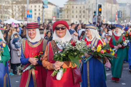 guilds: Zurich Switzerland  April 13 2015  Women in traditional costumes on the traditional annual spring parade of Guilds Sechselauten or Sachsiluute as celebration of end of winter.