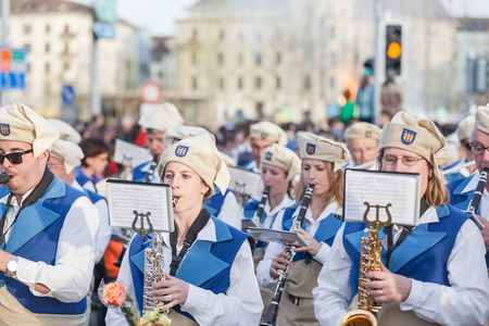 guilds: Zurich Switzerland  April 13 2015  People in traditional costumes playing instrument on the traditional annual spring parade of Guilds Sechselauten or Sachsiluute as celebration of end of winter. Editorial