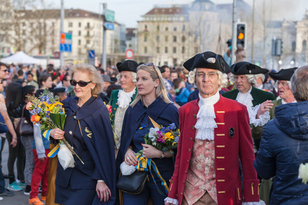 guilds: Zurich Switzerland  April 13 2015  People in traditional costumes on the traditional annual spring parade of Guilds Sechselauten or Sachsiluute as celebration of end of winter.