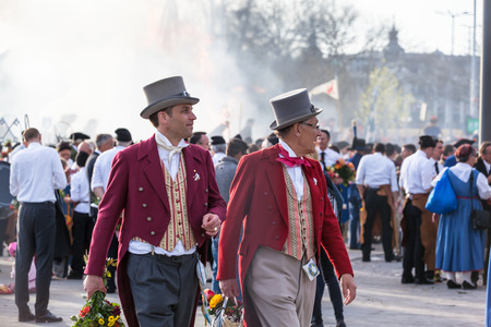 guilds: Zurich Switzerland  April 13 2015  Men in traditional costumes on the traditional annual spring parade of Guilds Sechselauten or Sachsiluute as celebration of end of winter.