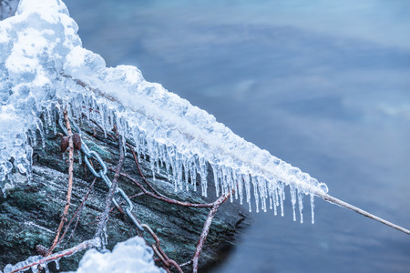 edge of the ice: Close up view of ice snow and frost on frozen rope and steel chain on water edge. Concept of cold winter frost frustration darkness etc. Copy space available.